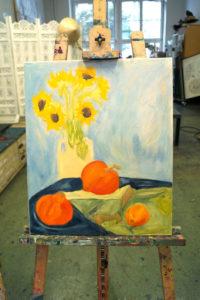 Sonnenblumen und Kürbisse